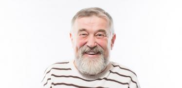 An elderly man smiling